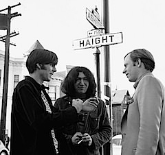 1966, Haight-Ashbury, San Francisco, Calfornia, USA --- Jerry Garcia (c) and Rock Scully (l), manager of the rock band the Grateful Dead, speak to author Tom Wolfe at the corner of Haight and Ashbury. --- Image by � Ted Streshinsky/CORBIS