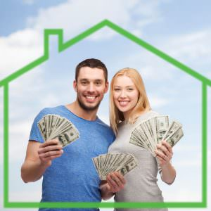 35173856 - love, home, people and family concept - smiling couple holding dollar cash money over green house and blue sky background